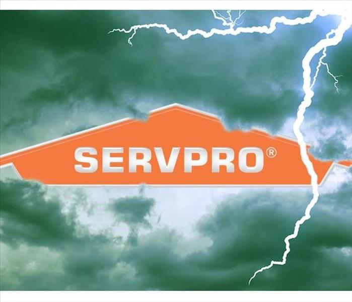 SERVPRO logo on a backdrop of stormy clouds.